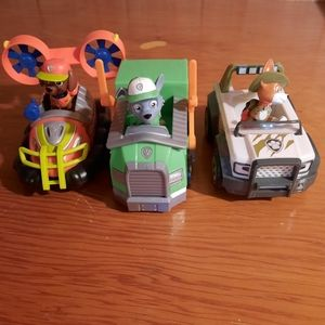 Lot with 3 paw patrol figures and their vehicles